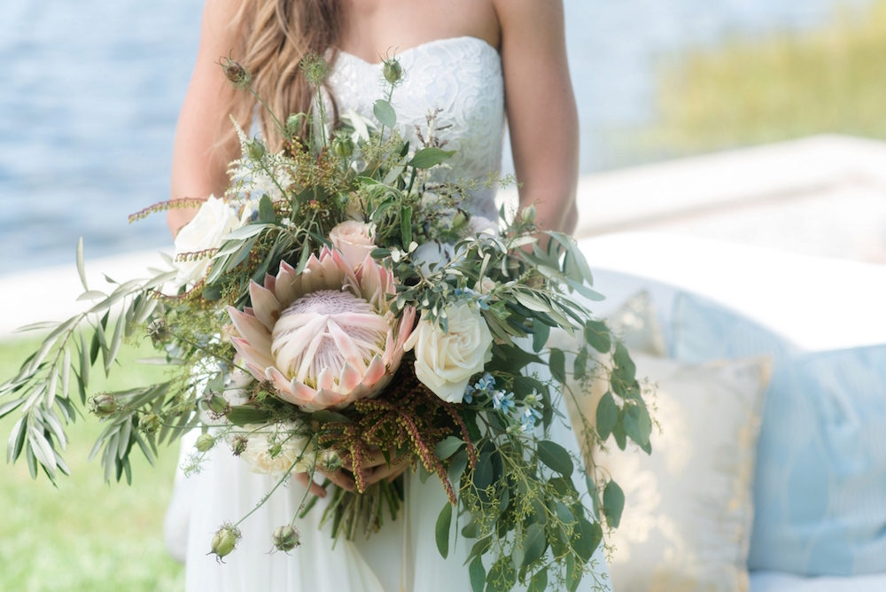 Coastal Chic Wedding Inspiration with a spectacular Protea Wedding Bouquet / dresses by Dessy / photo by Caroline & Evan Photography / flowers by FH Weddings & Events