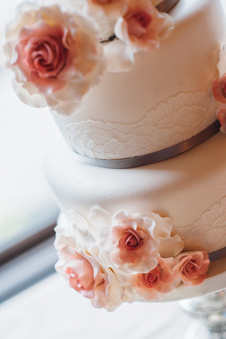 Pretty Cream Wedding Cake with Pastel Sugar Flowers / photo by Pure Aperture Photography / Created by Cake Box