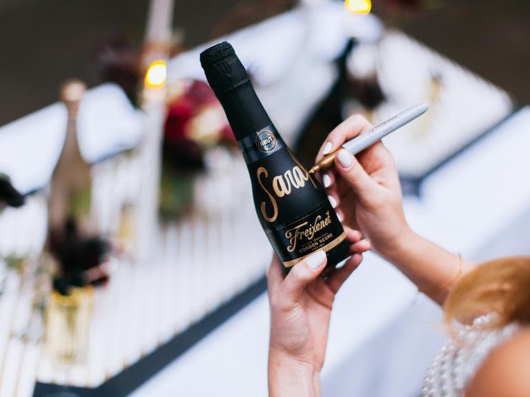 Personalize Bottles of Freixnet Brut in gold pen for wedding gifts and/or favors