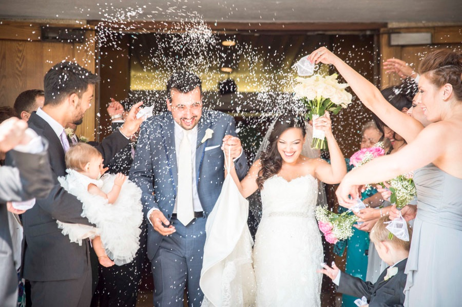 Great Capture of Wedding Ceremony Exit with Rice Confetti Toss {from 5 Reasons Why Hiring Professional Wedding Photographers + Videographers is Necessary} / image credit: Focus Productions in Toronto Canada