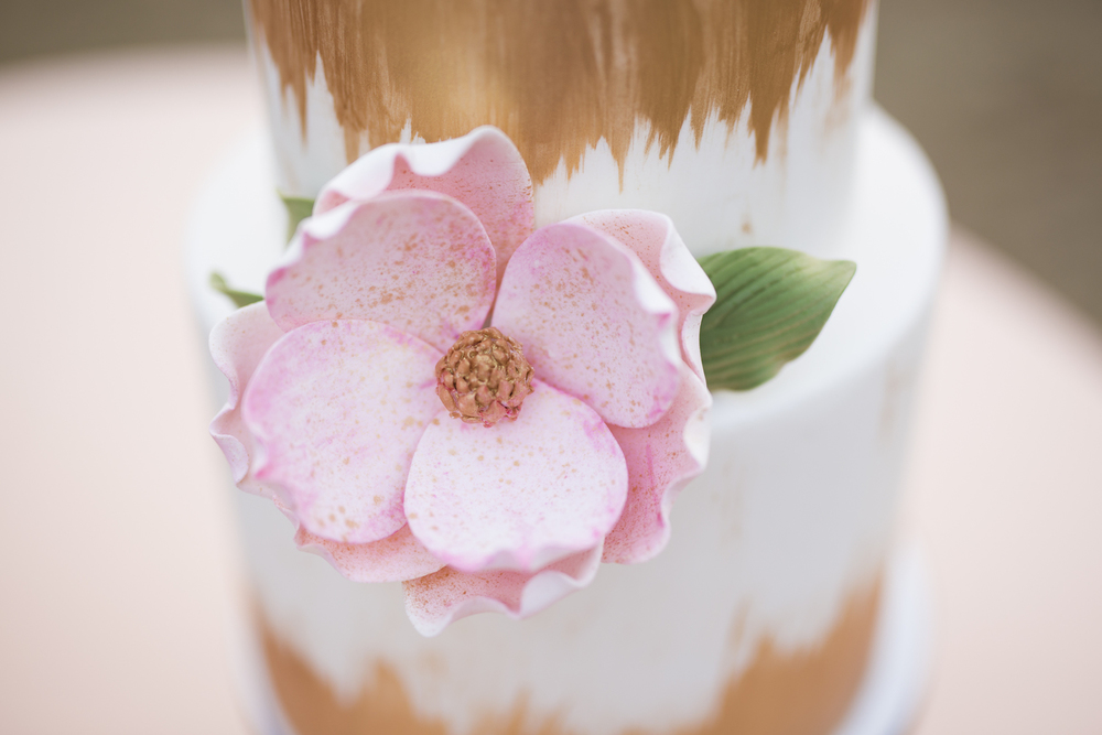 Large Sugar Floweron a Gold and White Wedding Cake / designed by Ella's Celestial Cake / photo by Kevyn Dixon Photo