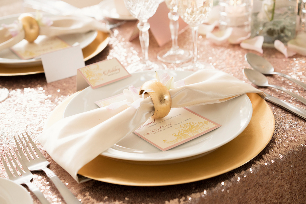 Blush Pink Sweetheart Wedding Tablescape with Fancy Glassware, Gold Charger + Napkin Wrapped around Dish / design by Madeline's Weddings and Events / photo by AMC Studio