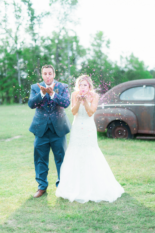 Fun Bride and Groom Portrait with a Confetti Toss / photo by Hannah Ruth Photography LLC