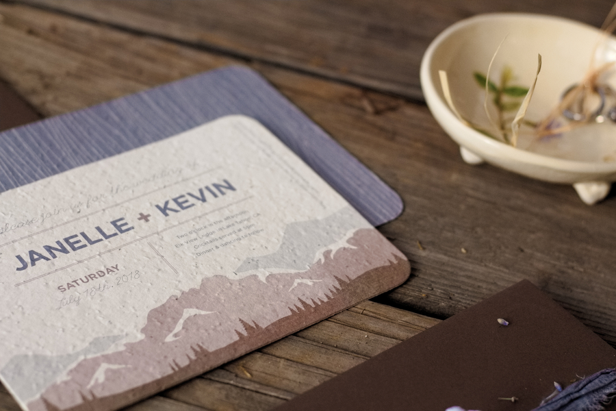 Detail of Pretty Recycled Paper Wedding Invitations infused with Wildflower Seeds for a Mountain Wedding / photo by Autumn Noel Photography