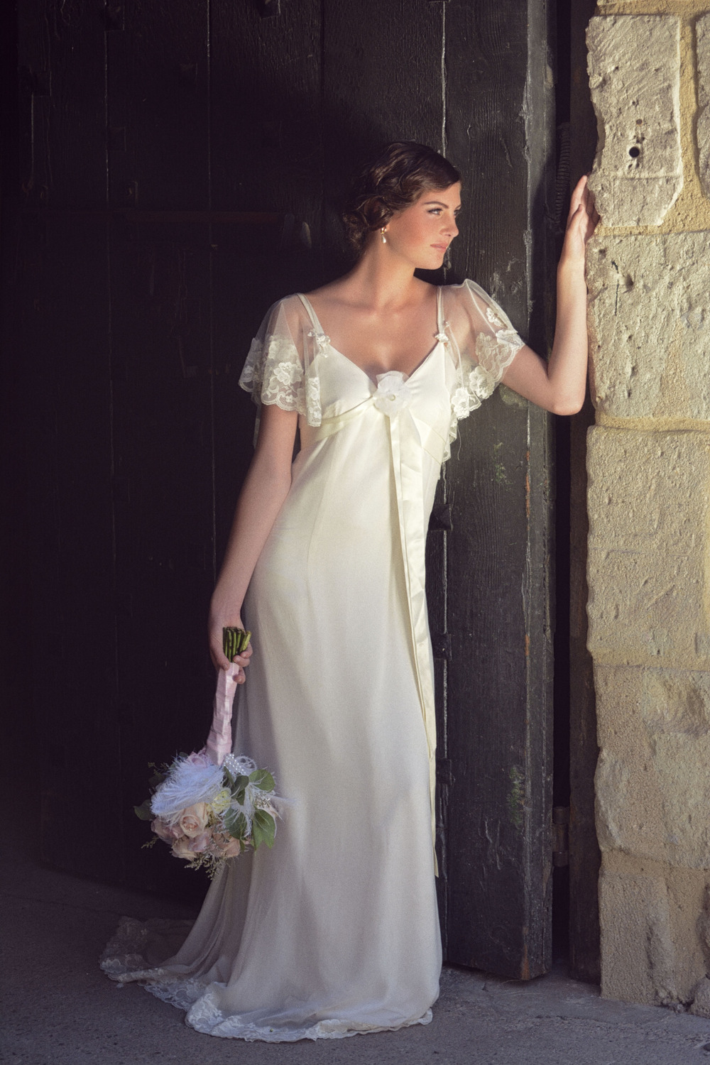 Cosette Wedding Gown: Silk chiffon empire cut evening gown silhouette with butterfly style sleeves trimmed in Chantilly lace. From Amy Jo Tatum Bridal Couture