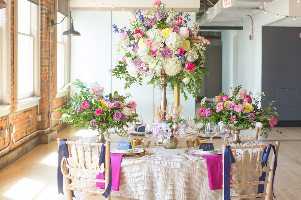 Stunning Wedding Tablescape with lush floral design in navy blue + cerise - inspired by Preston Bailey / Florals by EightTreeStreet / Photography by Amy Nicole