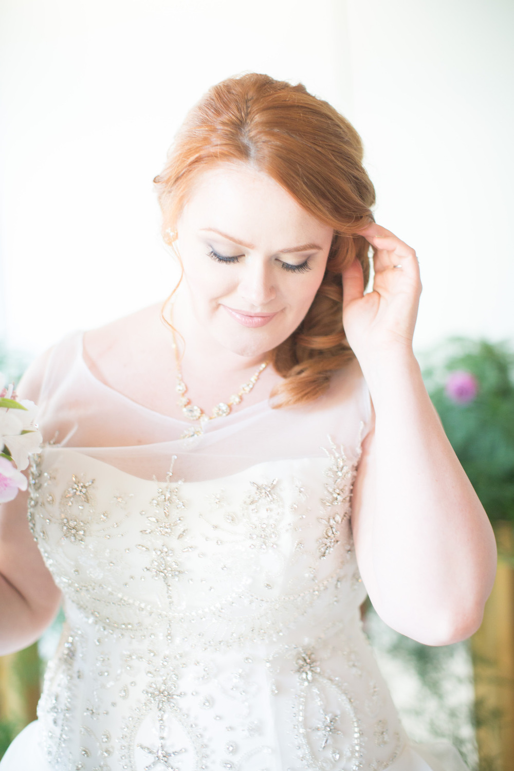 Pretty Bridal Portrait with a Beaded Wedding Gown / Photography by Amy Nicole