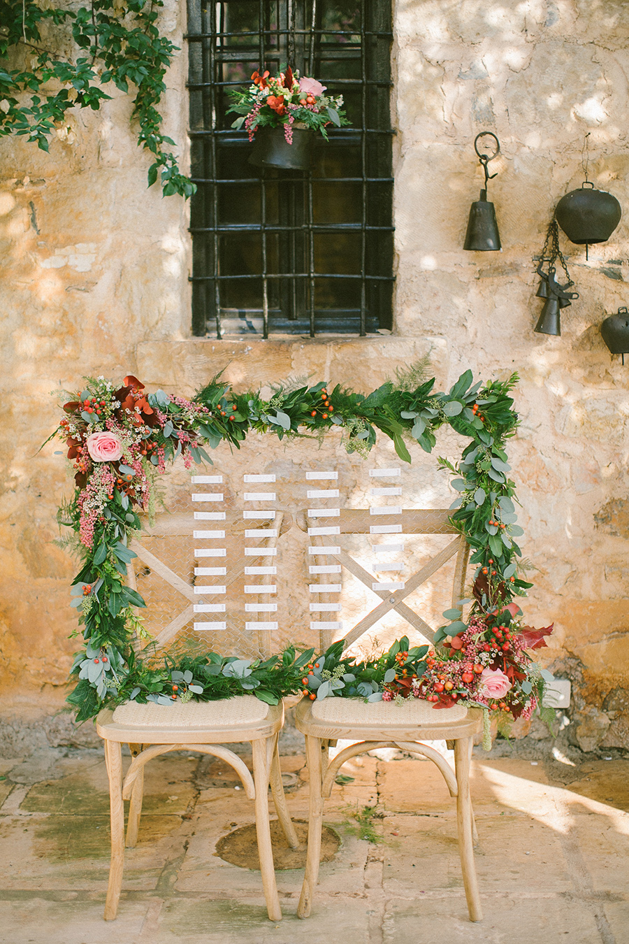 Boho Chic Themed Seating Chart - frame surrounded by flowerls and greenery / styled shoot coordinated by Love 4 Wed / photo by Anna Roussos Photography
