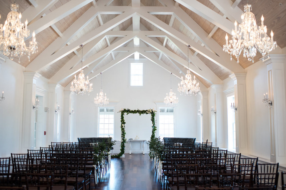 White Barn Wedding Ceremony Location with Crystal Chandeliers / Séverine Photography