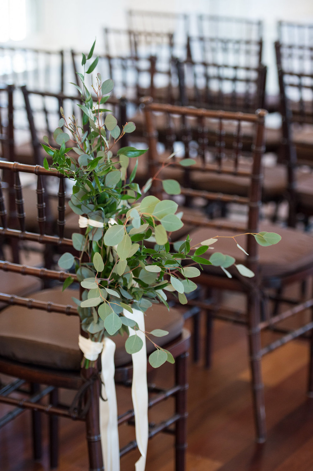 Pretty Greenery for the Ceremony Chair Decorations from a Summer Wedding in Florida / Séverine Photography