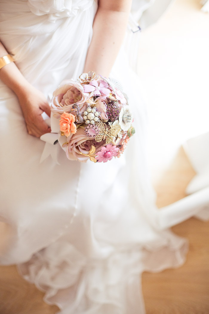 Pink Wedding Brooch Bouquet with Flowers and Vintage Charms / from 14 Ways Real Brides Plan to Sparkle on their Wedding Day