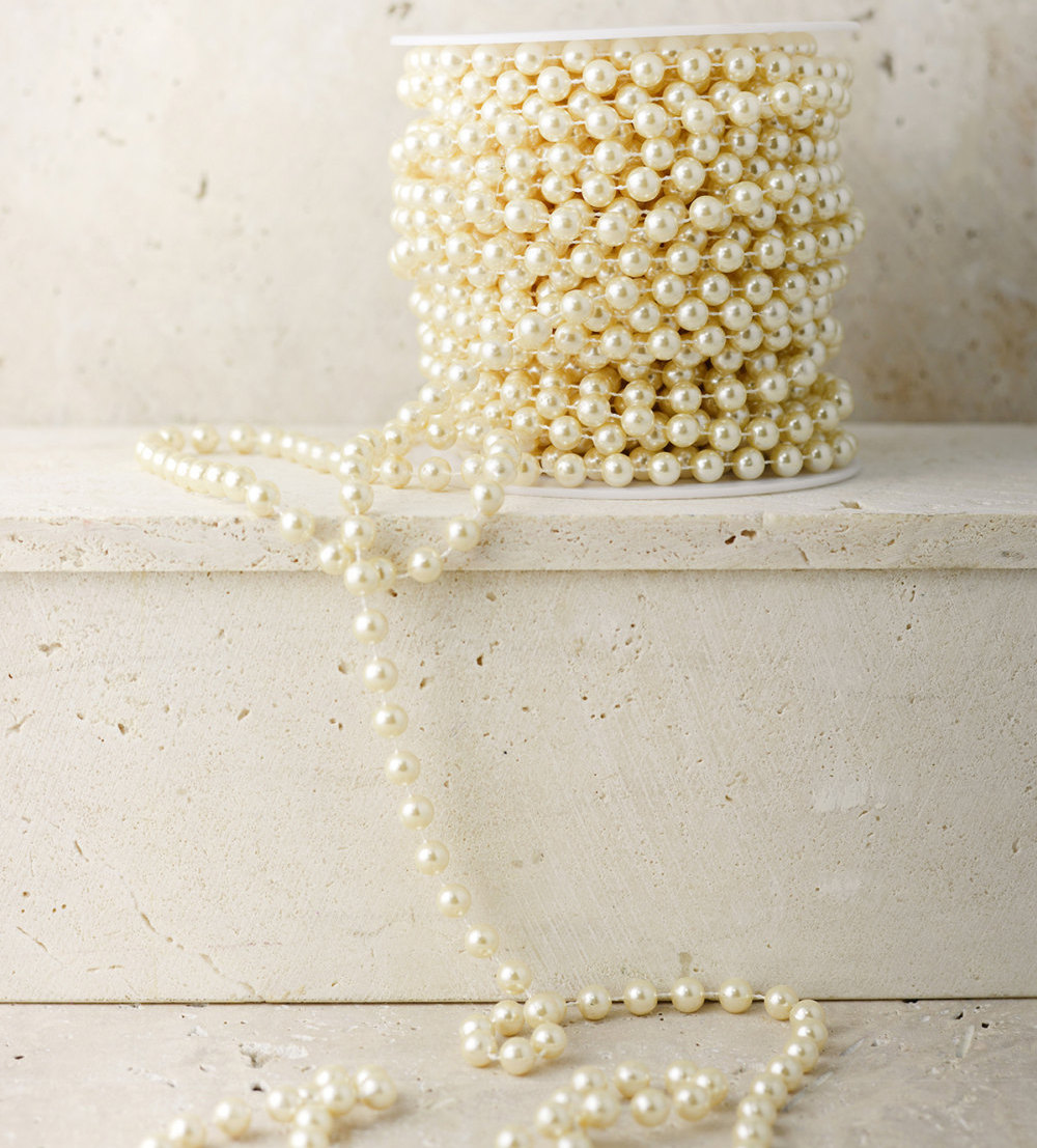 Wedding Pearl Garland for Decorations - perfect for Gatsby themed weddings / from 14 Ways Real Brides Plan to Sparkle on their Wedding Day