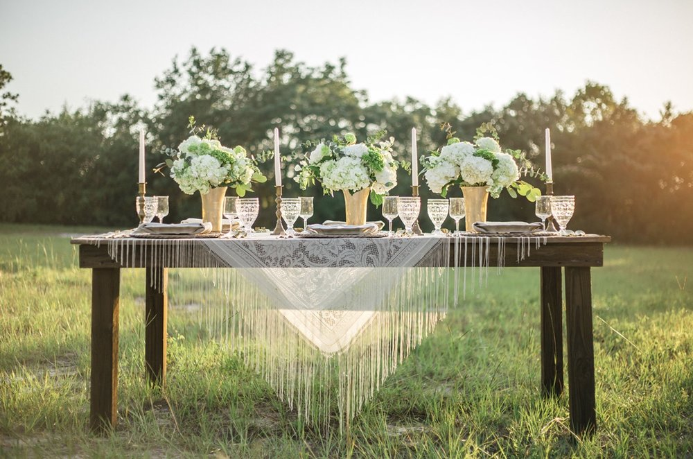 Sunset Florida Wedding Inspiration : love this fringe table covering and gold vases / photo by Cristina Danielle Photography