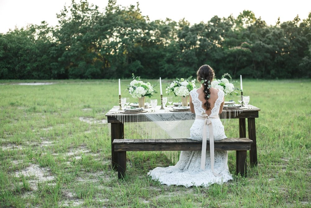 Stunning Bride with a long braid {greenery tucked in} and a beautiful Lace Wedding Dress / from a Sunset Florida Wedding Styled Shoot / photo by Cristina Danielle Photography