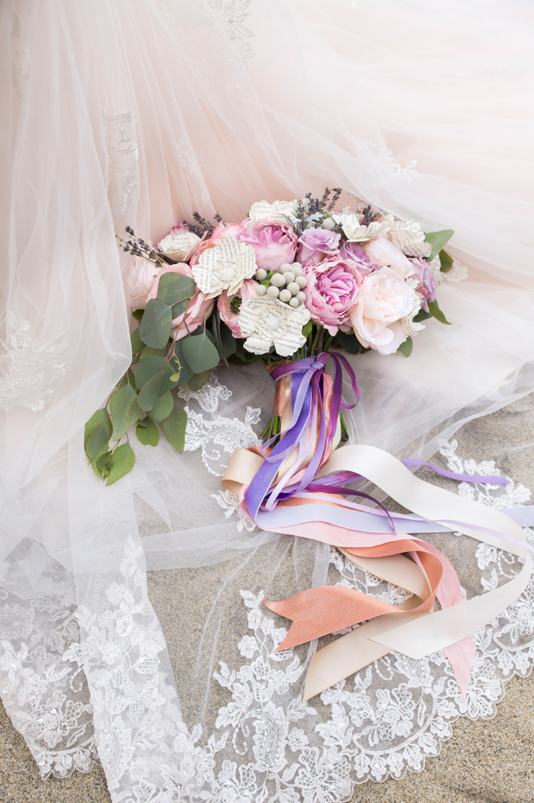 disney-harry-potter-wedding-shoot-102016-bouquet-on-dress.jpg