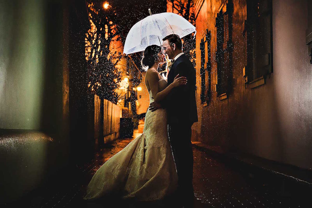 You'll wish for rain on your wedding day when your bride and groom portrait look like this / stunning nighttime wedding photograph in the rain / photo by Rae Leytham Photography / St. Augustine Florida