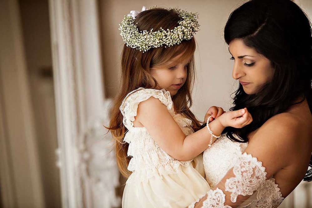 Gorgeous Wedding Photograph of a bride and her flower girl / photo by Rae Leytham Photography / St. Augustine Florida