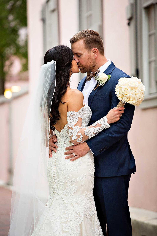 planning-wedding-on-budget-bride-groom-kiss.jpg