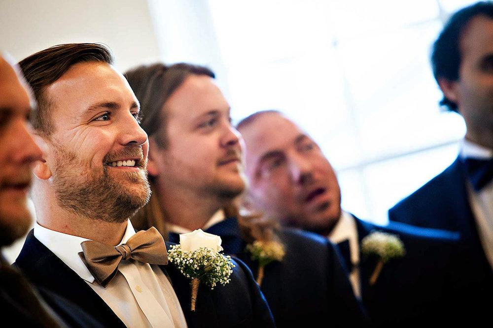 planning-wedding-on-budget-groom-first-look.jpg