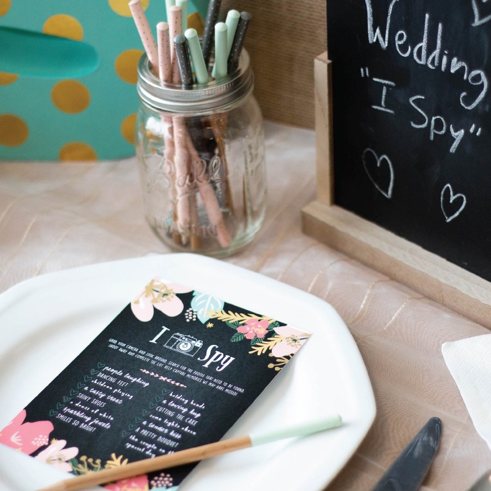 Such a fun wedding idea . . . an I Spy wedding themed game at each place setting for wedding receptions or bridal showers. The game cards feature a floral chalkboard design which makes them a perfect match for your rustic styled reception. From Paperramma - see more creative wedding ideas on www.BrendasWeddingBlog.com