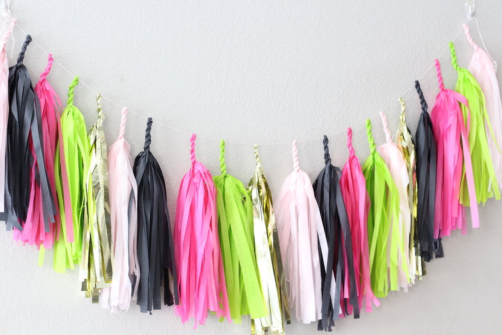 Color Coordinated Tassel Garland for a Let's Flamingo Bachelorette Party {or a bridal shower, even a bridal brunch as the theme is super versatile}. Hot Pink, Black, Gold and Green Color Palette. As seen on www.brendasweddingblog.com