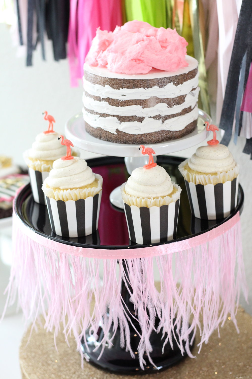 Party Inspiration for a Let's Flamingo Bachelorette Party or Bridal Shower - a fun flamingo party theme in pink, white, black, green and gold. Rustic naked cake topped with cotton candy and cupcakes topped with plastic flamingos. As seen on www.BrendasWeddingBlog.com