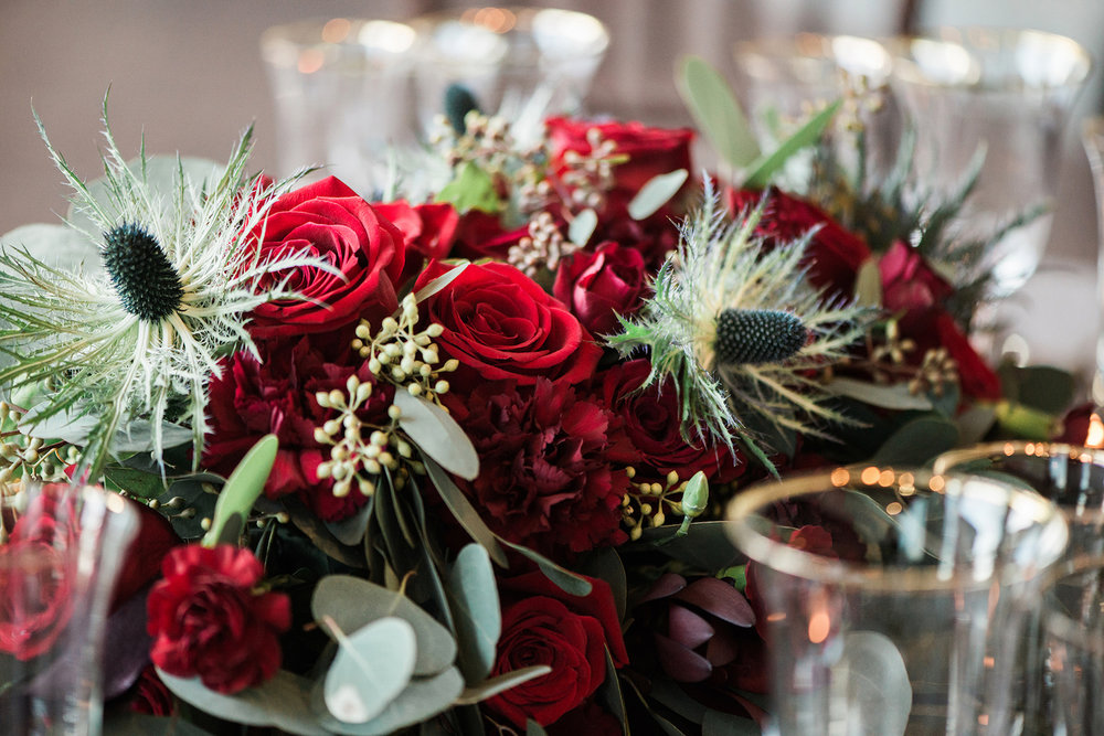 Gorgeous Red Roses and Carnations with Thistle — luxurious and romantic vintage wedding inspiration — photo by Marianne Blackham Photography — as seen on www.BrendasWeddingBlog.com