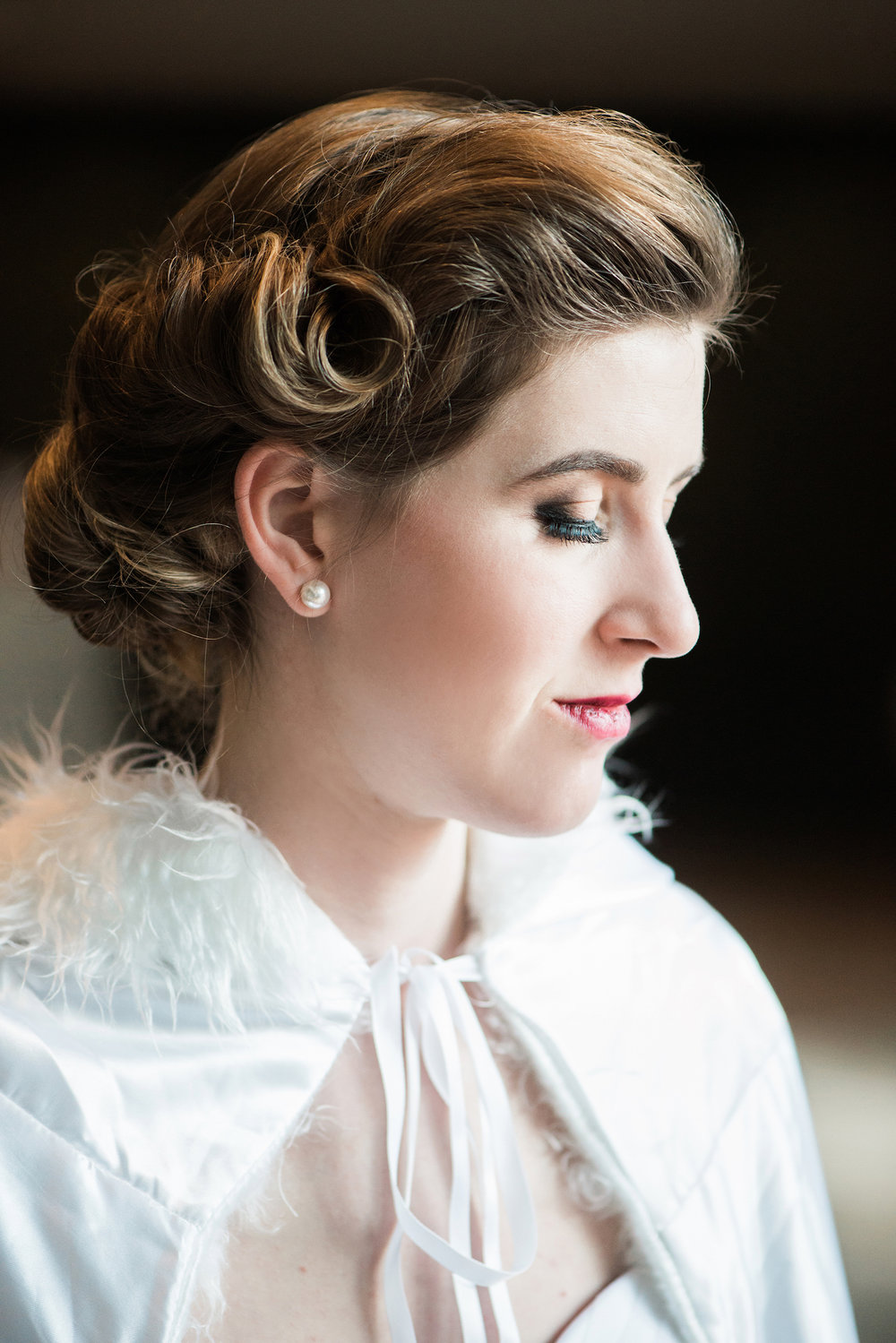 Gorgeous Vintage Vibe Bridal Hairstyle — Luxurious and romantic vintage wedding inspiration in an urban venue — photo by Marianne Blackham Photography — as seen on www.BrendasWeddingBlog.com