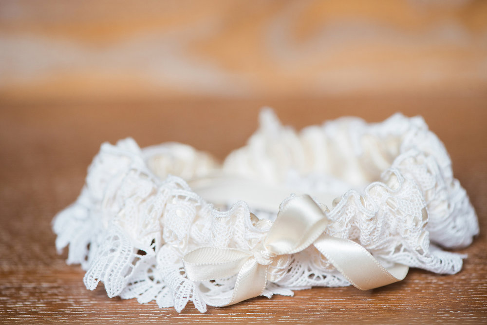 Lace Wedding Garter from The Garter Girl — Luxurious and romantic vintage wedding inspiration in an urban venue — photo by Marianne Blackham Photography — as seen on www.BrendasWeddingBlog.com