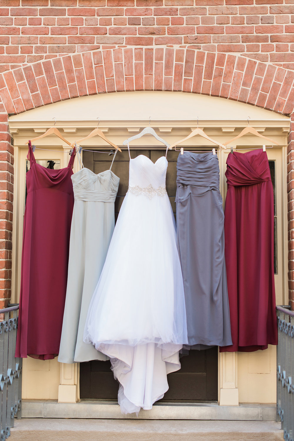 Red and Grey Bridesmaid Dresses — Luxurious and romantic vintage wedding inspiration in an urban venue — photo by Marianne Blackham Photography — as seen on www.BrendasWeddingBlog.com