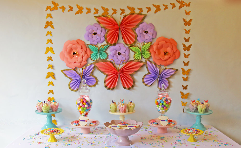 Paper Flowers and Butterflies make the perfect backdrop for the dessert table at a spring bridal shower — Click to see 37 Creative DIY Wedding Ideas for Spring — as seen on www.BrendasWeddingBlog.com