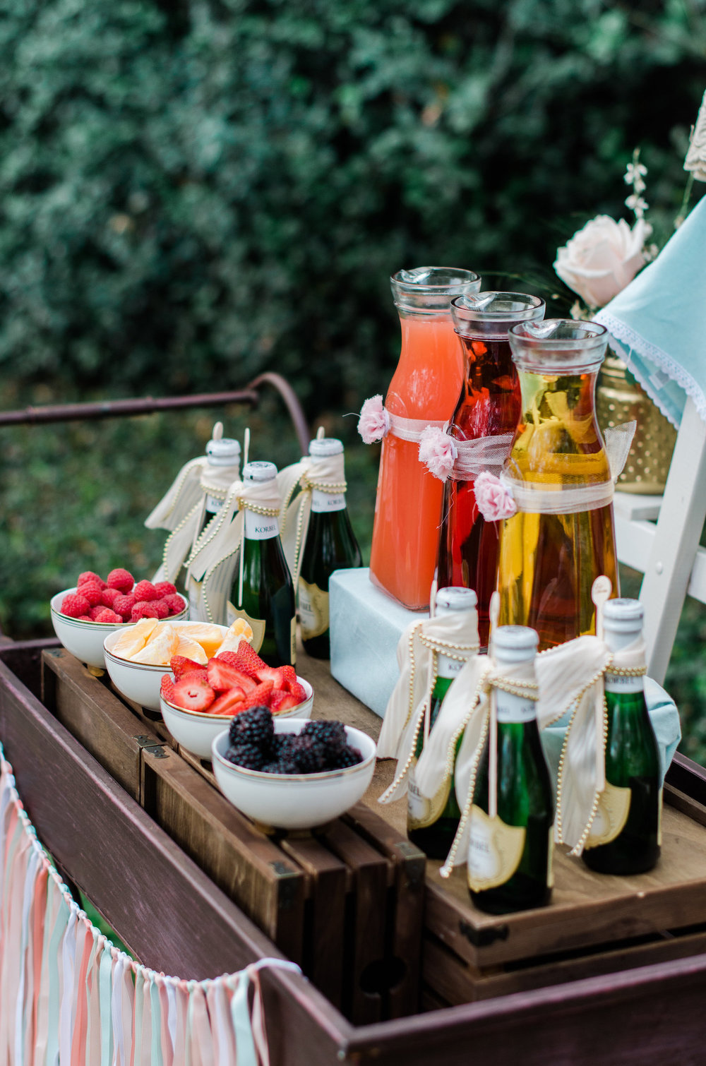 Beautiful Mimosa Station set up on a darling vintage serving cart with fresh berries — Click to see 8 DIY Wedding Ideas for a Springtime Bridal Shower Brunch — Part of the 37 Creative DIY Wedding Ideas for Spring as seen on www.BrendasWeddingBlog.com