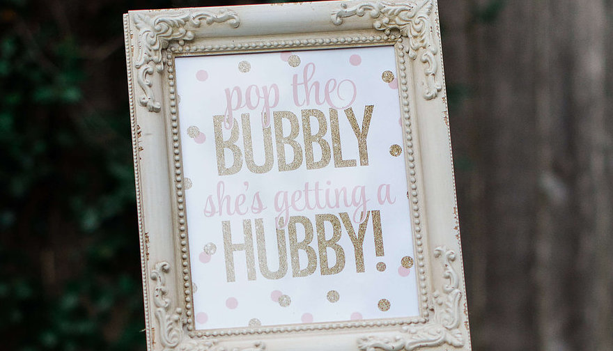 "A framed ""pop the bubbly she's getting a hubby"" printable is perfect as added party decor — Click to see 8 DIY Wedding Ideas for a Springtime Bridal Shower Brunch — Part of the 37 Creative DIY Wedding Ideas for Spring as seen on www.BrendasWeddingBlog.com"