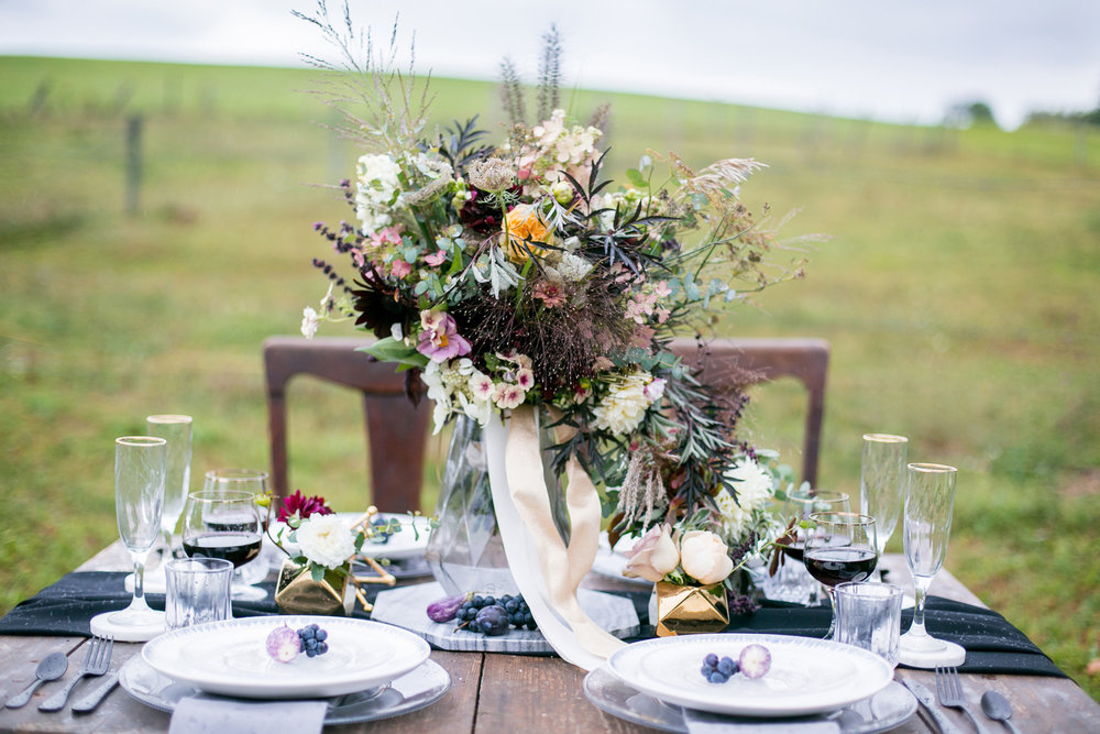 Moody and Dramatic Wedding Ideas and Inspiration for an outdoor wedding tablescape - photo by Chantal Routhier Photography — click to see more inspiration on www.BrendasWeddingBlog.com