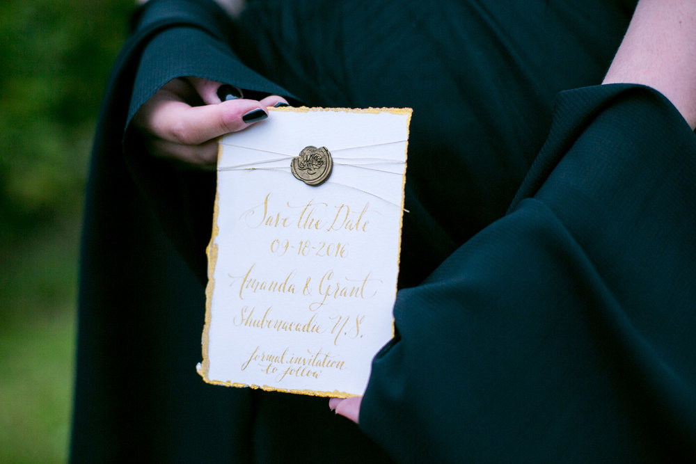 Gold Edged Save the Date with a Wax Seal — Moody and Dramatic Wedding Ideas + Inspiration — photo by Chantal Routhier Photography — click to see more inspiration on www.BrendasWeddingBlog.com