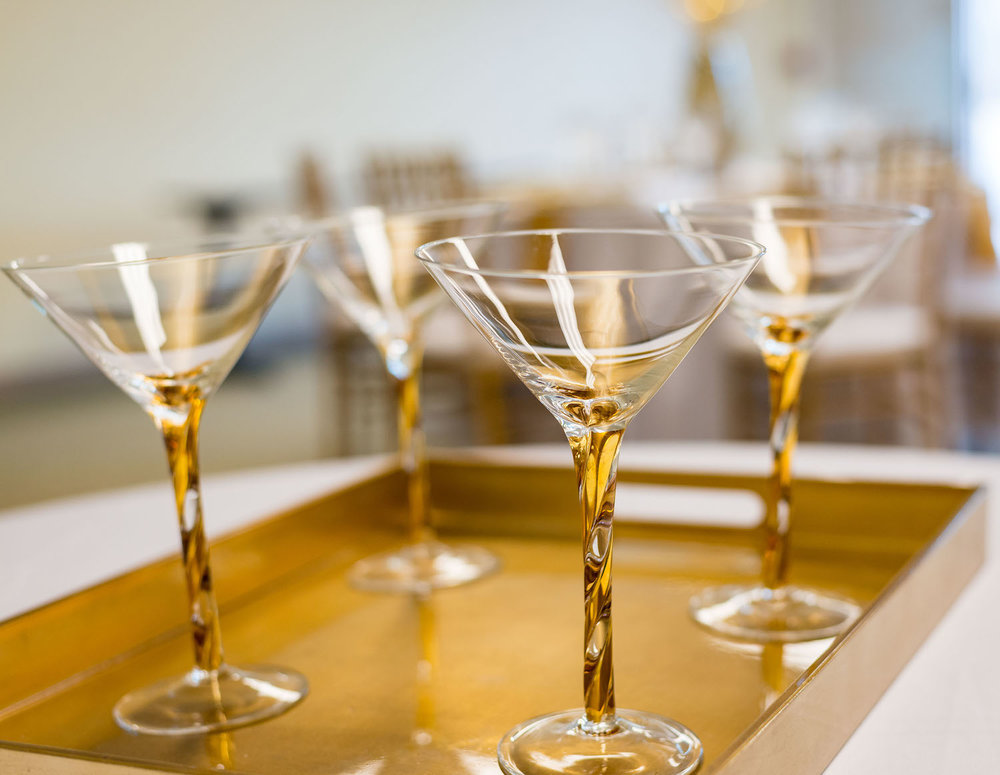 Pretty Gold Stemmed Martini Glasses for a sophisticated wedding / designed by Monika Michelle Events / North Carolina Weddings and Events Planner / see more on www.BrendasWeddingBlog.com