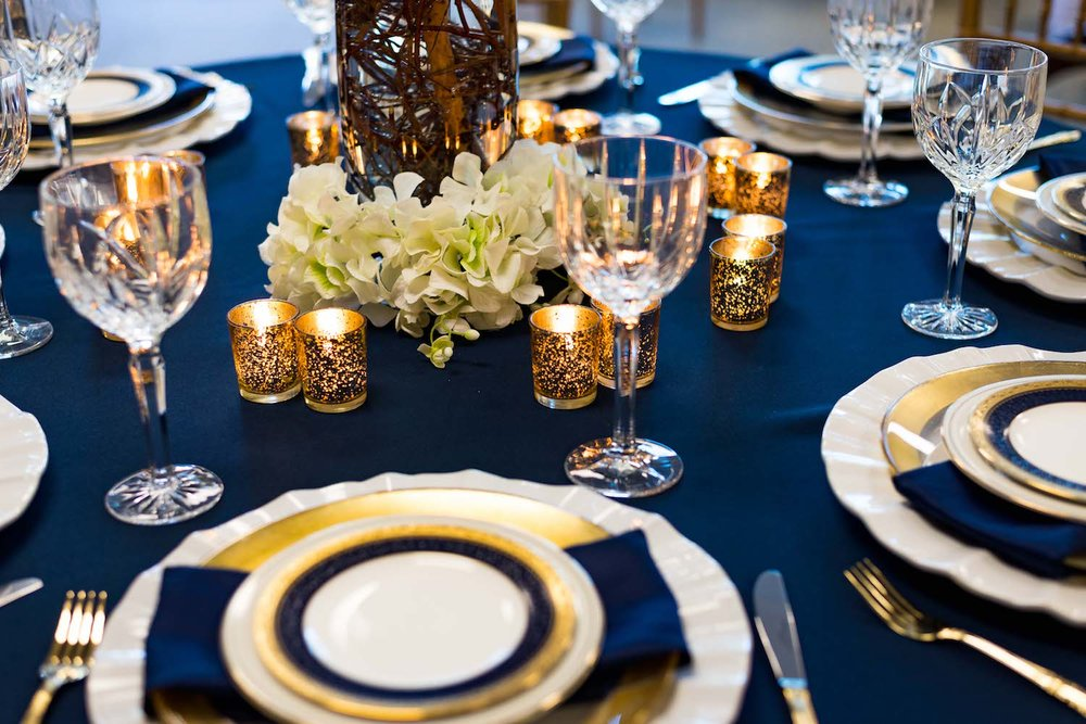 Elegant Blue and Gold Tablescape with votives and hydrangeas / designed by Monika Michelle Events / North Carolina Weddings and Events Planner / see more on www.BrendasWeddingBlog.com