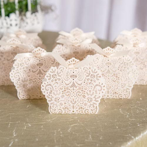 This luscious foil lace wedding favor box with ribbon is perfect packaging for a decadent treat or a miniature trinket. Features embossing with touches of metallic gold. Available from Madeline's Weddings - as seen on www.BrendasWeddingBlog.com