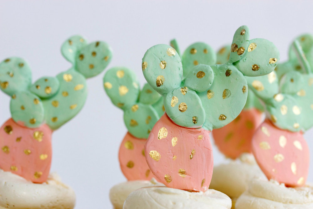 Top your wedding cake or cupcakes with edible fondant cactus toppers. As seen in Cactus Wedding Ideas - a hot wedding trend on www.BrendasWeddingBlog.com