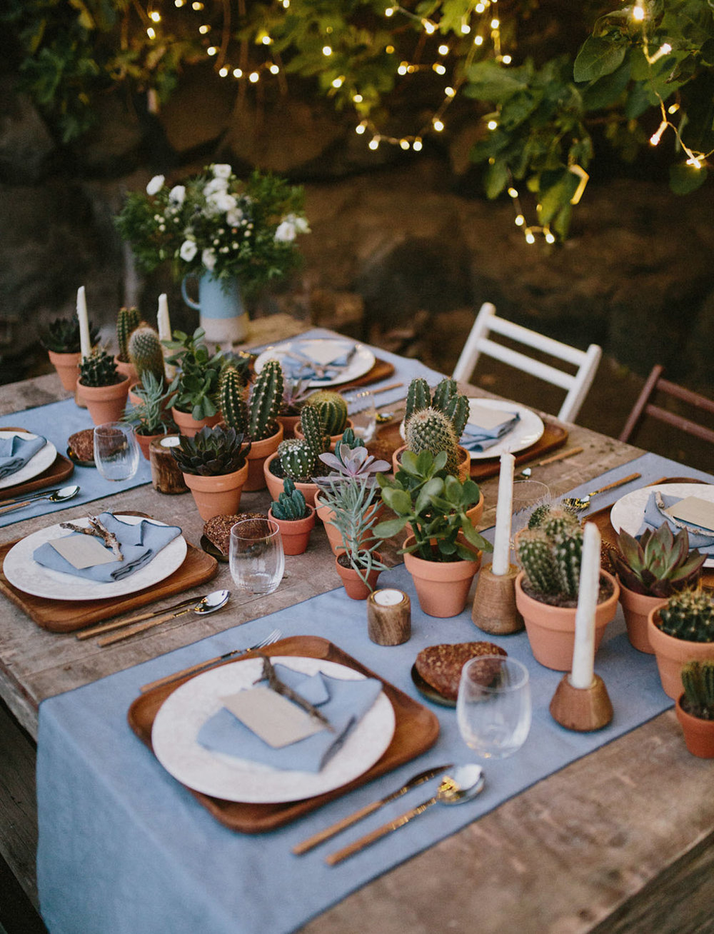 Create a fun table runner with cactus in cute clay pots. As seen in Cactus Wedding Ideas - a hot wedding trend on www.BrendasWeddingBlog.com