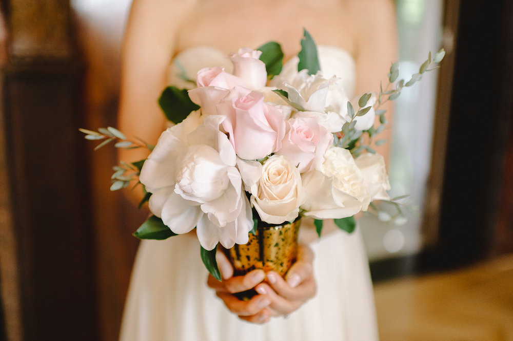 Pretty pastel pink and white rose wedding centerpiece in distressed gold vase - designed by EightTreeStreet Floral - wedding floral designer in Washington DC Maryland - as seen on www.brendasweddingblog.com