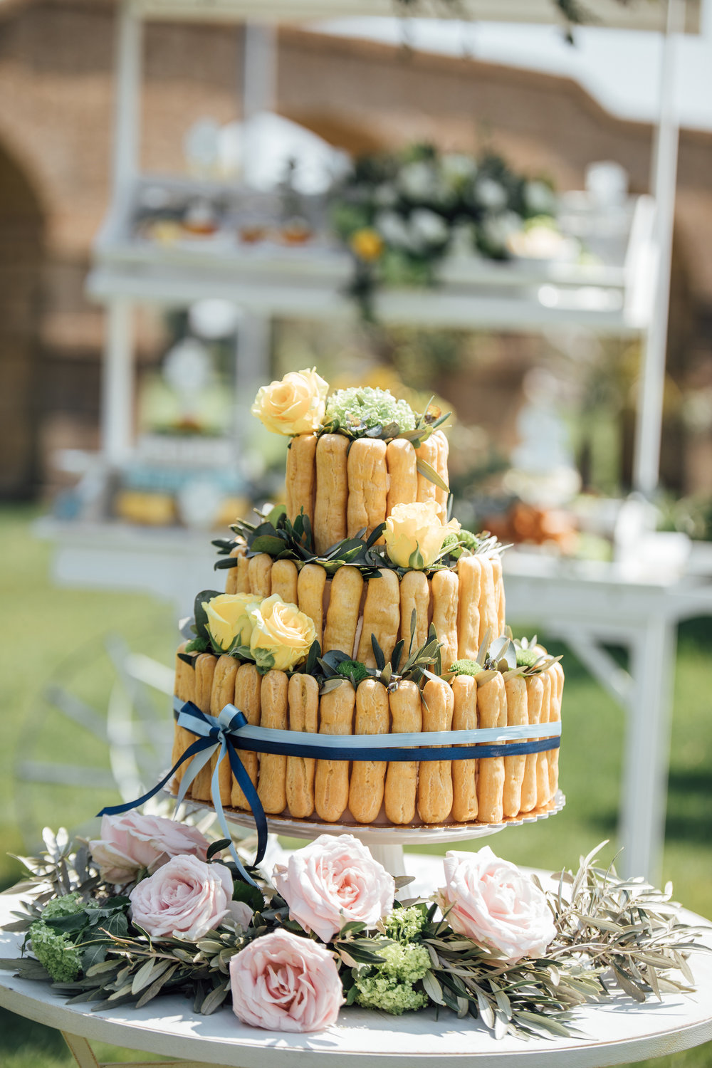 Tiered Lady Finger Wedding Cake with fresh flowers from a Garden Wedding Styled Shoot in Rome Italy - by Jess Palatucci Photography - as seen on www.BrendasWeddingBlog.com