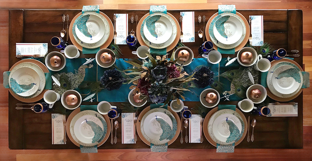 The prettiest peacock wedding tablescape / cobalt and teal table setting with peacocks / gold pomegranates with edible gold paint for party favors / as seen on Brenda's Wedding Blog www.brendasweddingblog.com / design and styling by Bri of Halfpint Design