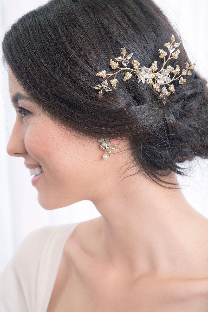Handset Swarovski crystals on a hair vine style comb. Light and flexible for easy, comfortable placement in your hair.Available in gold (as shown), or silver. From Laura Jayne Adornments / as seen on Brenda's Wedding Blog www.brendasweddingblog.com