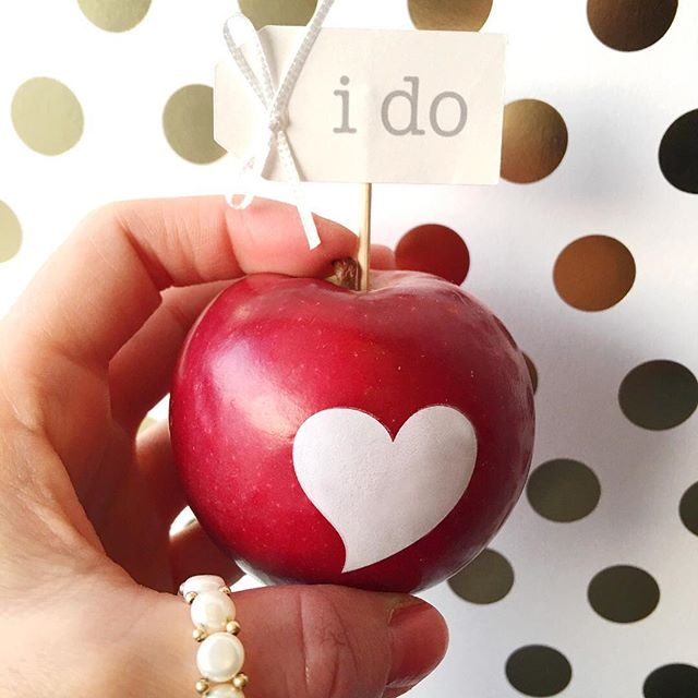 Here's to Saying I Do this #EngagementSeason with a heart imprinted apple from @funtoeatfruit and a pretty #CupcakeTopper from @goagainstthegrain. Be sure to follow @weddingsites and stay tuned as this is just a little preview of a fun collaboration coming soon to the blog 😊 - - - - - #weddingfavors #weddingfavor #weddingfavorideas #weddinglove #bridetobe2018 #creativewedding #creativeweddings #engagedlife #weddingdetails #handmadeshop #creativeentrepreneur #abmlifeissweet #momentsofmine #creatorslane #creativelifehappylife #wedspiration #myunicornlife #cupcaketoppers #soontobemrs #proposalseason #weddingplanningadvice #weddingtips #gettinghitched #newlyengaged #herecomesthebride #bridestyle #soontobemarried