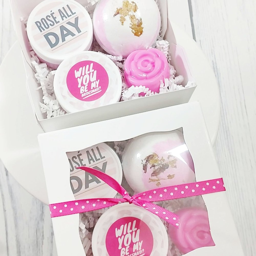 Ask your girlfriends to be your bridesmaid with this beautiful WILL  YOU BE MY BRIDESMAID proposal bath box gift set. This 4 piece bath and body gift set arrives gift boxed with a pretty bow and ready for gifting with 4 all natural handmade bath gifts for your bridesmaid. From Sunbasil Garden Soap on etsy - as seen on Brenda's Wedding Blog www.brendasweddingblog.com #weddinggift #bridesmaidgift #willyoubemybridesmaid #handmadegift