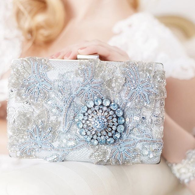 "Something Borrowed, Something Blue, Something ""Bling"" - @cloenoeldesigns knows all brides need a little bling and this clutch is simply fabulous. Click my profile link to see the full details on this Something Blue Rhinestone Clutch.⠀ -⠀ -⠀ -⠀ -⠀ -⠀ #bridalaccessories #huffpostido #somethingblue #clutches #marthaweddings #etsyseller #etsywedding #etsyweddings #letlovesparkle #allthatsparkles #weddingdaydetails #engagedlife #dailydoseofwhimsy #engagedtothedetails #tietheknot #herecomesthebride #weddingmusthave #brendasweddingblog #etsyhandmade #justengaged #newlyengaged #romanticwedding #elegantweddings #bride2019 #classicbride #ad"