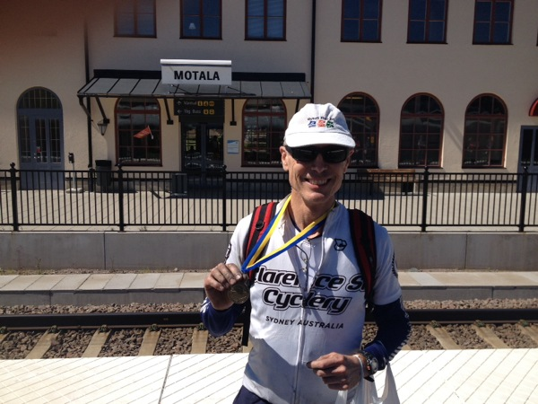 Leaving Motola by train to Stockholm- I do love that medal.