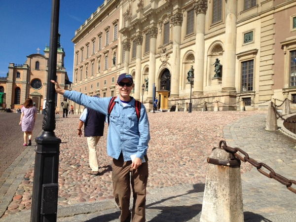 The cyclist being a tourist at the Royal Palace.