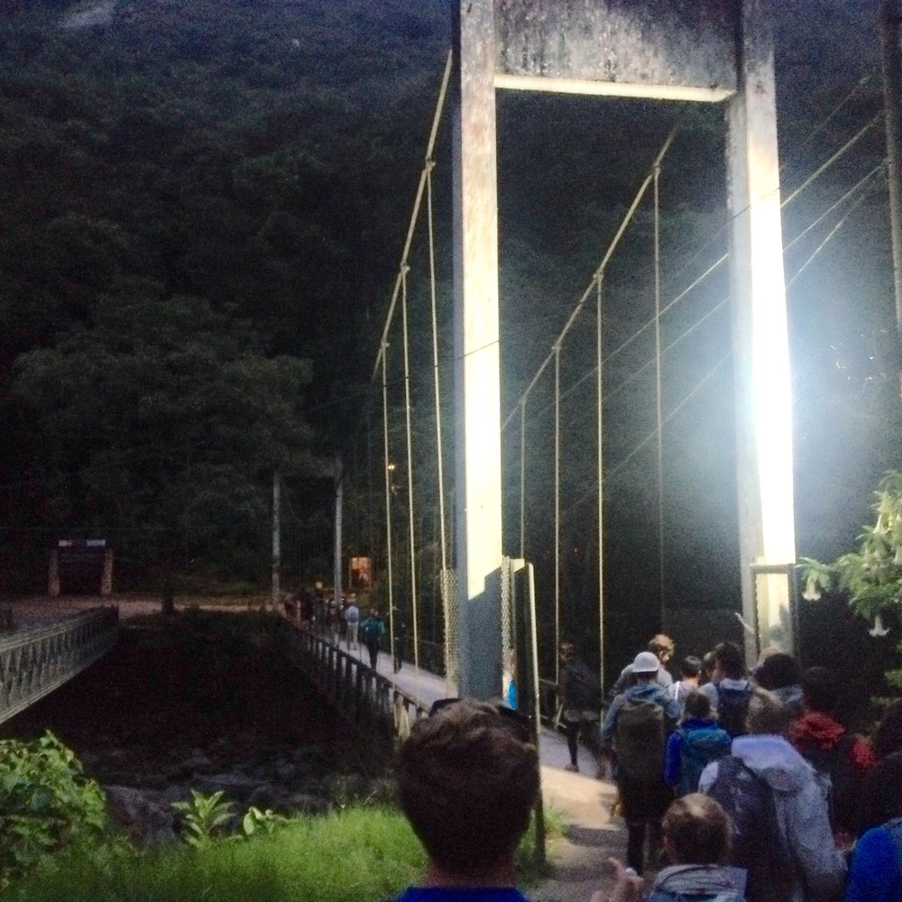 The walking bridge opened at 5:00 after 30 mins walk in the dark.